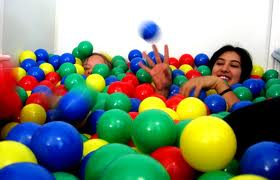 girl in pit of balls